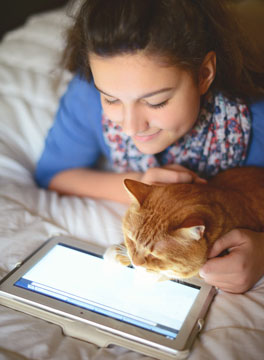 Girl and cat on tablet